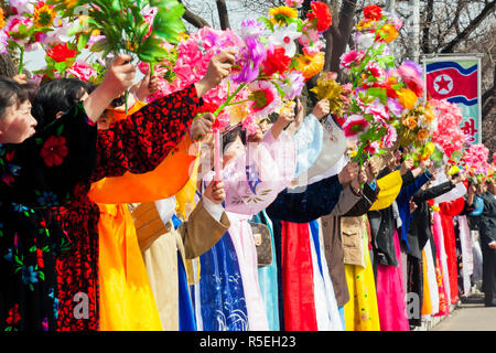 Democratic Peoples's Republic of Korea (DPRK), North Korea, Pyongyang, women in traditional dress during street celebrations on the 100th anniversay of the birth of President Kim IL Sung, April 15th 2012 - Stock Photo