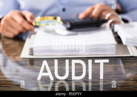 Financial Data Analyst With Audit Text On Desk - Stock Photo