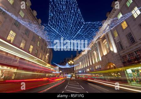 UK, England, London, Regents Street, Christmas Lights and Taxi - Stock Photo