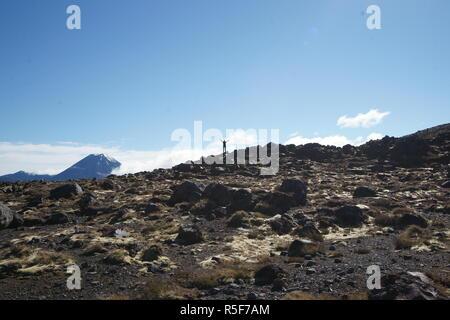 Tongariro alpine crossing - happy young woman on the horizon - Stock Photo