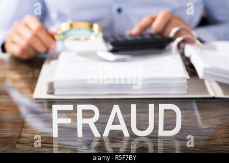 Fraud Text On Office Desk - Stock Photo