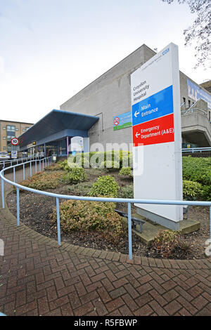 The main entrance to Croydon University Hospital in South London, UK. A typical regional hospital comprising Victorian buildings and modern extensions - Stock Photo