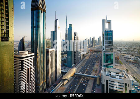 Elevated view over the modern Skyscrapers along Sheikh Zayed Road looking towards the Burj Kalifa, Dubai, United Arab Emirates - Stock Photo