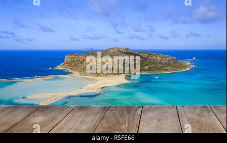 Empty wooden table with amazing view over Balos Lagoon and Gramvousa island on Crete, Greece - Stock Photo
