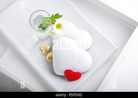 Colorful Valentine Cookies served on a white plate - Stock Photo