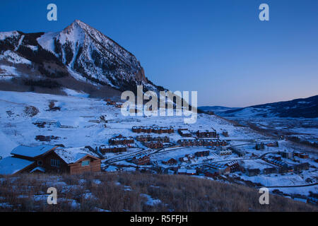 USA, Colorado, Crested Butte, Mount Crested Butte Ski Village, elevated view and Mount Crested Butte Mountain - Stock Photo