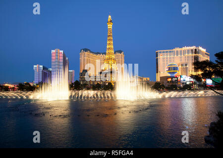United States of America, Nevada, Las Vegas, Bellagio fountains perform in front of the Eiffel Tower replica - Stock Photo