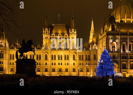 Christmas tree in front of the Hungarian Parliament Building, Europe - Stock Photo
