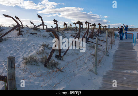 Tavira, Portugal - Oct 14th, 2018: Tourists taking pictures at Cemetery of Anchors. Memorial monument to dead fishermen of tuna industry in Portugal.  - Stock Photo