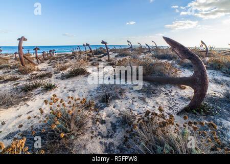 Cemetery of Anchors. Memorial monument to dead fishermen of tuna industry in Portugal. Barril beach, Santa Luzia, Algarve - Stock Photo