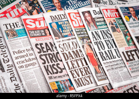 Row of Newspapers from the United Kingdom - Stock Photo