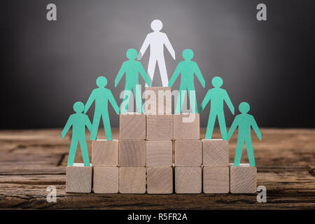 Paper Boss With Employees Standing On Wooden Blocks - Stock Photo
