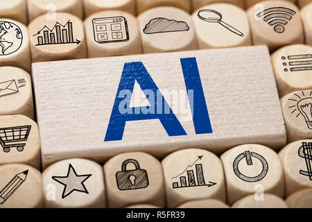 AI Text On Wooden Block Surrounded By Computer Icons - Stock Photo