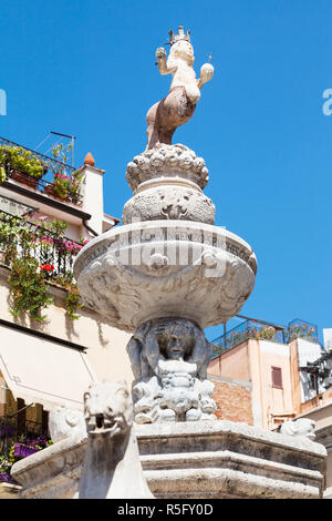 figure of baroque style fountain in Taormina - Stock Photo