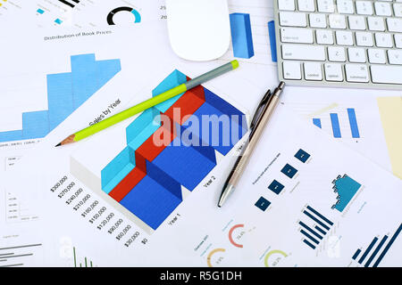 Picture of chart paper, pen, pencil, mouse and keyboard on the table. - Stock Photo