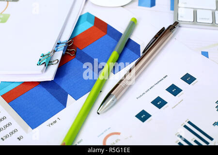 Picture of chart paper, pen and pencil on the table. - Stock Photo