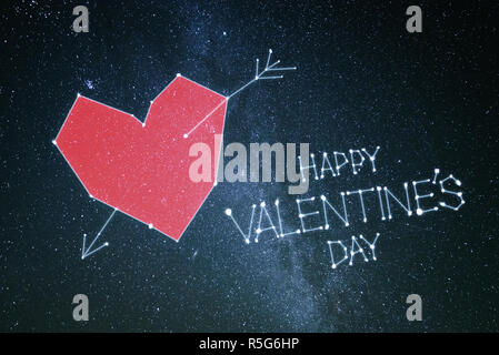 Happy Valentine's day. Greeting card with red heart and lettering on a black background - Stock Photo