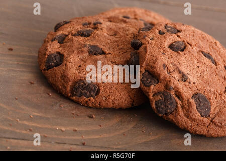 Sweeet life. Chocolate cookies isolated on table cllose-up - Stock Photo