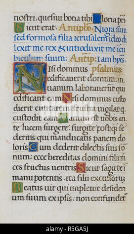 Text page with initial 'N'. Mirandola Hours. Italy, circa 1490-1499. [Whole folio] Text page from the Hours of the Virgin. The end of Psalm 121; Psalm 126 with initial 'N', formed of branches against a scenic background Image taken from Mirandola Hours. Originally published/produced in Italy, circa 1490-1499. Source: Add. 50002, f.42v. Language: Latin. - Stock Photo