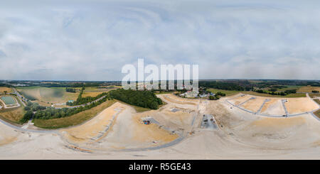 360-degree panorama of a rainwater retention basin at the edge of a new development next to a country road in Germany, taken in flight with the drone. - Stock Photo
