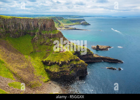 The Amphitheatre, Port Reostan Bay and Giant's Causeway on background, County Antrim, Northern Ireland, UK - Stock Photo