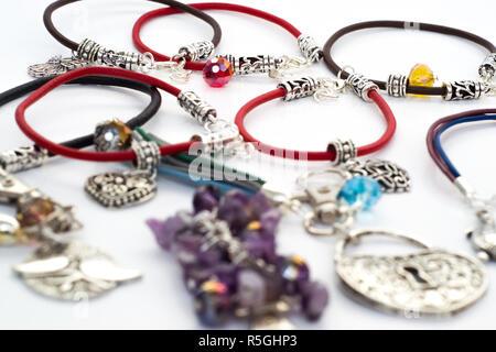 Handmade bracelets isolated on white background - Stock Photo