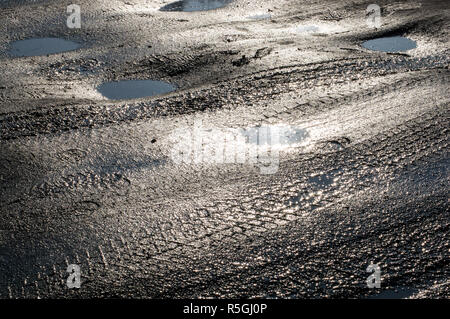 Puddles on the road - Stock Photo