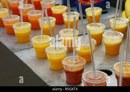 Assorted fruit juices and smoothies in retail - Stock Photo