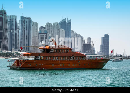 Luxury vintage yacht anchored in Dubai Marina, United Arab Emirates - Stock Photo