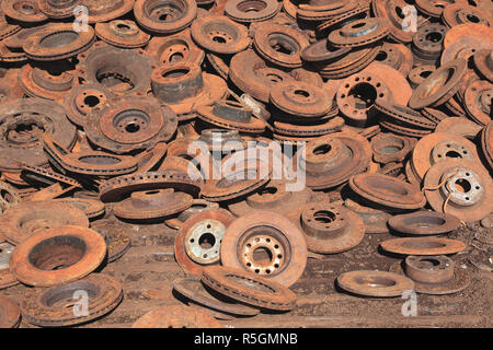 Scrap iron, here brake discs from cars, scrap yard, recycling plant, Germany - Stock Photo
