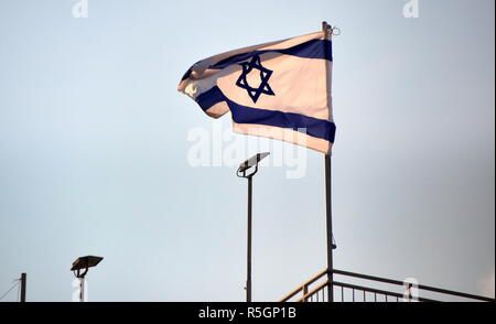 israeli flag blowing in the wind in jerusalem - Stock Photo