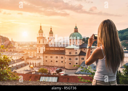 Tourist taking a photo of beatiful sunset in Salzburg Austria - Stock Photo