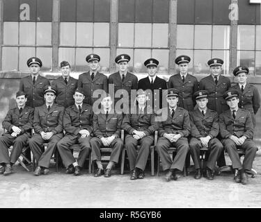 Officers in  future President George H. W. Bush's squadron at NAS Norfolk, VA with Bush standing, third from the right, Norfolk, VA, 02/1944. - Stock Photo