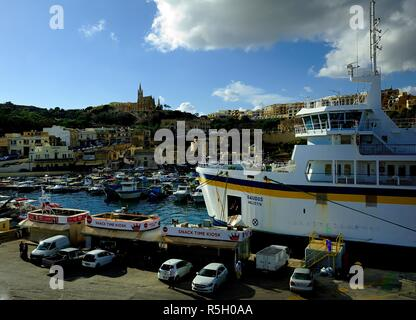 Mgarr harbour, Gozo - 8th October 2018:Gaudos ferry in the harbour of Mgarr - Stock Photo