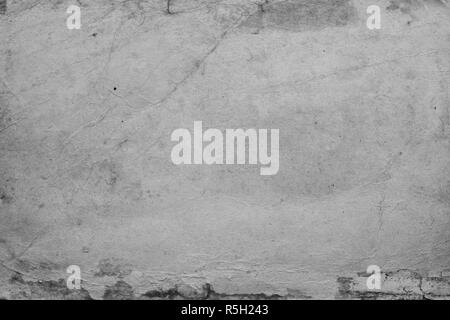 A plain piece of grey paper with a worn surface - Stock Photo