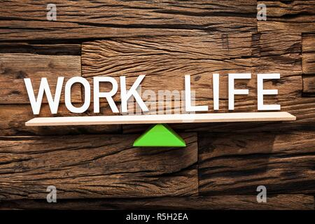 Text Work And Life Balancing On Seesaw - Stock Photo