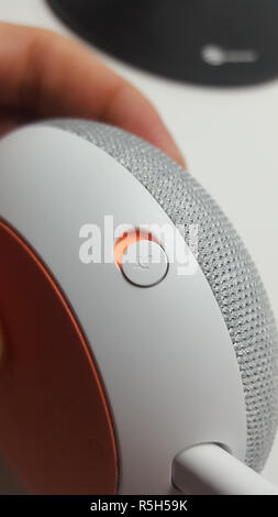 microphone button of a Google Home Mini device - Stock Photo