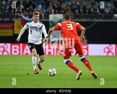 Leipzig, Germany - November 15, 2018. German national football team striker Timo Werner against Russian defender Roman Neustaedter during internationa - Stock Photo