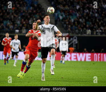 Leipzig, Germany - November 15, 2018. Germany national football team centre back Niklas Sule against Russian forward Anton Zabolotny during internatio - Stock Photo