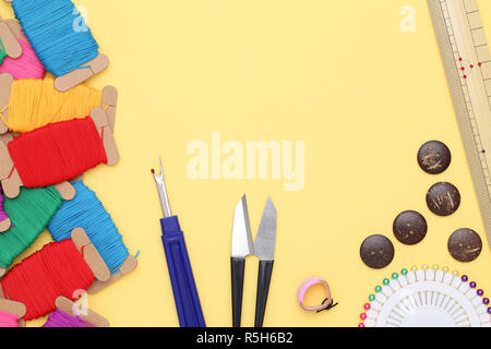 sewing tools, tailoring and fashion concept - close-up on yellow background - Stock Photo