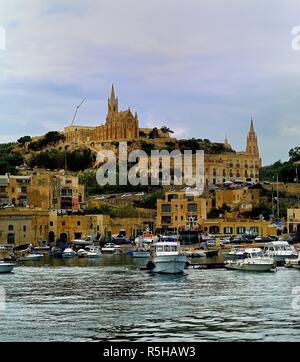 Mgarr harbour, Gozo - 8th October 2018:pleasure craft in the harbour of Mgarr - Stock Photo