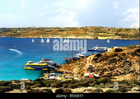 Comino, Malta - 12th October 2018:Yachts at anchor in the blue lagoon - Stock Photo