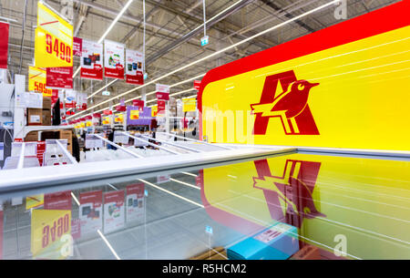 Samara, Russia - November 18, 2018: Auchan trade mark. French distribution network Auchan united more than 1300 shops - Stock Photo