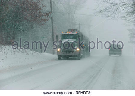 Rehoboth, Massachusetts, USA - December 31, 2008: Snowstorm reducing visibility on two-lane highway - Stock Photo