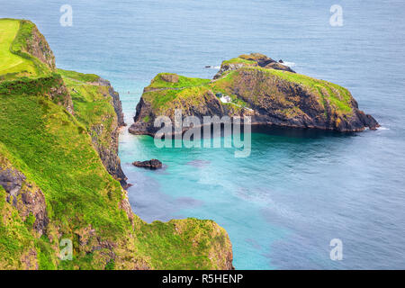 aerial view of the Carrick-a-Rede Rope Bridge and Carrickarede island, UK - Stock Photo