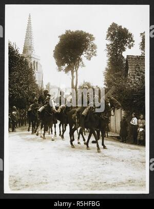 Indian cavalry marching through a French village [Estrée Blanche]. Troopers of the 3rd Cavalry and the 18th Lancers riding through Estrée Blanche, the church spire in the background, 25th July 1915. Record of the Indian Army in Europe during the First World War. 20th century, 25th July 1915. Gelatin silver prints. Source: Photo 24/(115). Author: Girdwood, H. D. - Stock Photo