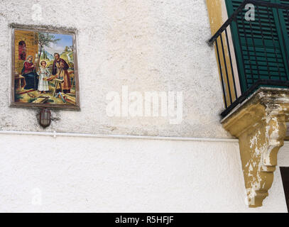 Religious paining on the wall of a house in the hilltop town of Bernalda in Basilicata, Southern Italy - Stock Photo