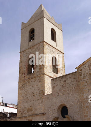 The tower of the church opposite the castle  of the hilltop town of Bernalda in Basilicata, Southern Italy - Stock Photo