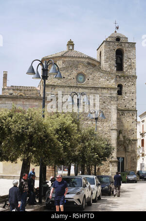 The hilltop town of Miglionico in Basilicata, Southern Italy showing the mother church of Santa Maria Maggiore and the main street. - Stock Photo