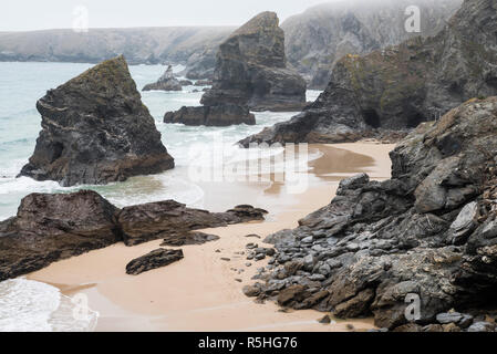 Looking down to the dramatic sea stacks at Bedruthan Steps from the south-west coast path in North Cornwall. - Stock Photo